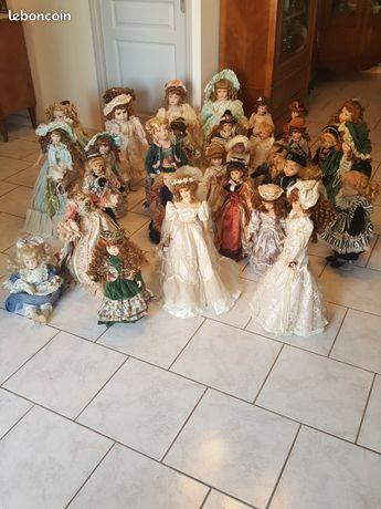 Lot 34 poupées de collection en porcelaine